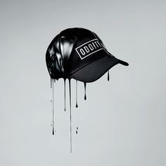 Oddity Cap, dripping paint, product photography