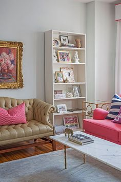 I'm trying to figure out what I covet the most, the faux bamboo gilded coffee table base with marble top, the candy coloured sofa, or the camel tufted rollarm sofa...but wait, then there is the art