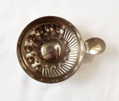 A silver plated tastevin by MaisonMaudie on Etsy, $16.00