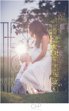 Maternity Pictures With Siblings | Big Brother Kissing Mom's Baby Bump
