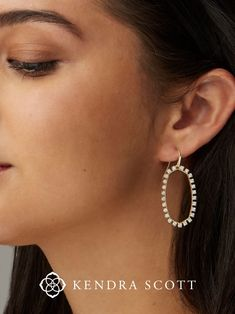 Say hello to a new way to wear these classically KS drop earrings. The Elle Open Frame Crystal Drop Earrings in Silver feature the shape you love with the weightlessness you want. The Elle Open Frame Crystal Drop Earrings the perfect addition to any outfit, even for graduation!