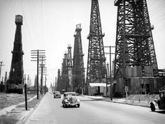Driving through a forest of derricks in Signal Hill. Circa 1937 photo by Herman Schultheis courtesy of the Photo Collection - Los Angeles Public Library. Pacific Coast Highway, Surf City, City Of Angels, Oil And Gas, Great Memories, Back In The Day, Abandoned Places, Landscape, Signal Hill