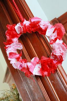 A wreath the kids can make for Valentine's Day - painted hearts and tissue paper!