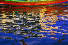 by KB Reflections of a traditional Maltese boat.