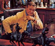 John Wayne in his home office