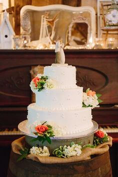 Barn wedding cake with Willow Tree cake topper
