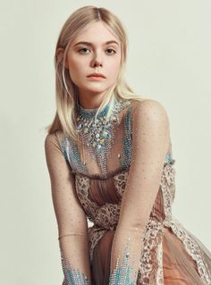 Elle Fanning is in full bloom on the May 2018 cover of Harper's Bazaar Germany. Photographed by Sofia Sanchez & Mauro Mongiello, the blonde poses in a Giambattista Valli Haute Couture gown. For the accompanying fashion shoot, Elle wears dreamy gowns and dresses from the spring collections. Stylist Kai Margrander