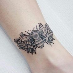 Bee and flowers tattoo