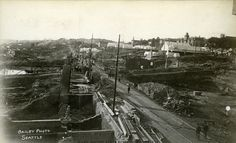 Washington State Historical Society - The rubble of the business district of Seattle after the fire of June 6th, 1889. Men walk along railroad tracks through the city and a tent city is visible in the upper left of the photo.