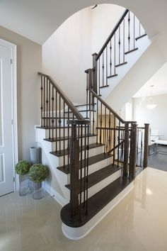 Stairs with wrought iron pickets are classic.