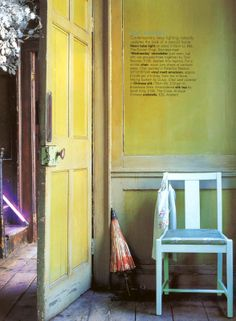 French Country hallway in lively shade of Yellow and Aqua Blue