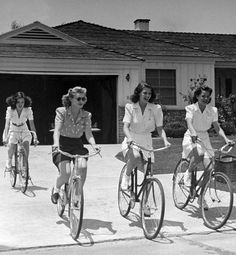 Cycle chic stars: Rita Hayworth and friends go for a ride 40s vintage fashion style casual shorts skirt playsuit sportswear