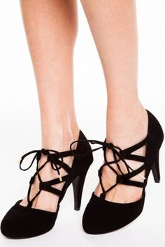 Show the world you're ready to take it on by slipping into the Damsel Divine Black Suede Lace-Up Pumps! Soft nubuck vegan suede forms a closed-toe upper with a caged lace-up front and a pointed heel. #heels #pumps #laceup