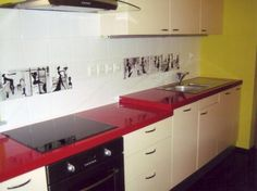 Another kitchen with red counters and (almost?) white cabinets. :D