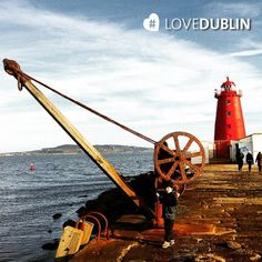 This stunning shot of the was taken by on A from the city extending out to bay Dublin Bay, Emerald Isle, Lighthouse, Seaside, Saints, January, Island, Photo And Video, City