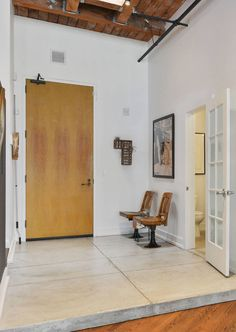 Factory Style Old Chairs in an Industrial Foyer Entryway with Concrete Floors via Melissa Winn Interiors Industrial Interior Design, Industrial Interiors, Industrial House, Smooth Concrete, Concrete Floors, Metal Furniture, Industrial Furniture, Entryway Decor, Foyer