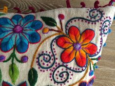 Embroidered flowers pillow