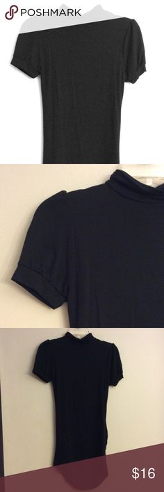 Murrangbee Tunic Blouse Short sleeve turtleneck choker black tunic shirt. U neckline or back cutout. You can actually wear this top two different ways, with the opening in the front, or the opening in the back, I can post pictures if interested. Murrangbee Tops Tunics