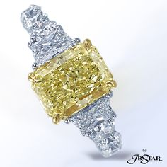 This stunning Platinum and 18KY Ring features a 3.01 ct. Radiant Fancy Yellow Diamond center with Trapezoid and Princess Diamonds.  By JB Star.