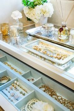 Custom Storage: Love the soft blue jewellery inserts.