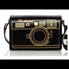 Kate Spade Camera Bag Crossbody Kate Spade Camera Bag Crossbody is the perfect travel companion! Such a cool piece to wear to Disney, On a cruise or anywhere at all! Eye catching and fun! Worn once for about two hours! No blemish at all- virtually brand new kate spade Bags Crossbody Bags