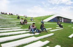 People can easily access the roof through the grass slope which would naturally attract people to rest and stopover. Image © Lianping Mao - Gallery of Second Stage of Hangzhou Cloud Town Exhibition Center / Approach Design (ZUP) - 21 Landscape Architecture Design, Green Architecture, Futuristic Architecture, Hangzhou, Park Landscape, Urban Landscape, Casa Patio, Sport Park, Outdoor Stairs