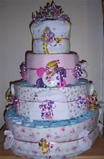 THIS CAKE IS MADE WITH ABOUT 150 BRAND DIAPERS, 4 RECEIVING BLANKETS,WASH CLOTHS, TOPPER, BIB, BURP CLOTH,  TOYS, SOCKS, PACIFIER, BRUSH, COMB, BABY SCISSORS, BABY NAIL FILE, CLIPPERS, CROWN, AND/OR ANY OTHER BABY RELATED ITEMS.     Unlike some other cakes, OURS come completely assembled and ready to use.  Just take it out of the box and you are ready for the shower! Everything is 100% usable, no glue used!