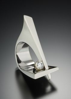 The Sculpture Ring ~ Dramatic, elemental, chic.  This wearable sculpture fits comfortably on the hand while making a bold statement. It is shown here in 14kt white gold with a .50 carat VS G diamond.  This ring may also be ordered in other gemstones and metals. For pricing, please call (415) 262-9985 or email: info@adamneeley.com