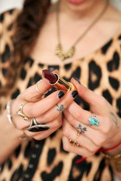 Fingers full of #rings, #tattoos and #nailpolish!