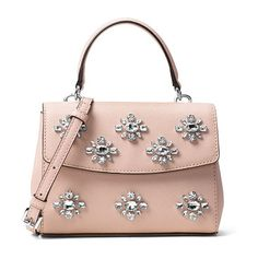 Ava extra-small jeweled crossbody bag by MICHAEL Michael Kors. MICHAEL Michael Kors jewel-embellished saffiano leather crossbody bag. Silvertone hardware. Flat top handle with ring...