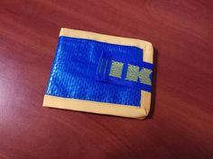 """Ultralight, ultrathin and waterproof wallet made from Ikea blue bag """"FRAKTA"""". Size Closed: 4 x 3 inches Open: 8 x 3 inches This wallet is recycle handmade! How To Make Clothes, Diy Clothes, Making Clothes, Ikea T Shirt, Transformers, Recycling, Feed Bags, Ikea Hacks, Unique Outfits"""