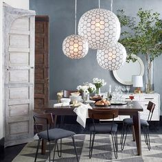 Good lighting is an art. Mix different sources like pedants/chandeliers + table lamps + mirrors to help make your space looks its best and brightest. (So much to love about this room, but our Capiz Orb Pendants steal the show!)  #westelm #styletip #hairpinlegs