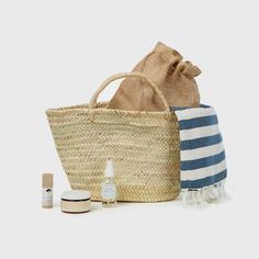 This Summer, we decided to create the perfect beach bag for long days under the sun. We included a classic striped Turkish towel, natural sunscreen, a healing lip balm, and texturizing salt spray, all tucked inside a handmade straw bag. Gift this to someone special or treat yourself to a few new goodies.