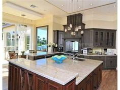 The different wood in the island and the cabinets is so different, but they work well together