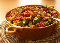 Okra, Corn and Tomatoes  From Betty's Soul Food Collection... Almost too pretty to eat, this recipe is seasoned with bacon, hot pepper sauce, onions and garlic..