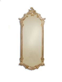 Traditional cast gesso mirror finished in dusty antiqued silver with gold highlights.