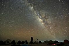 The 'Milky Way' is seen in the night sky around telescopes and camps of people over rocks in the White Desert north of the Farafra Oasis southwest of Cairo, May REUTERS/Amr Abdallah Dalsh Gaia, Solar Mass, Fermi Paradox, Nighttime Sky, Quantum Entanglement, Light Pollution, Astrophysics, France, Milky Way