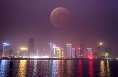 The photo above, taken using multiple exposures, shows the blood moon in the sky during a total lunar eclipse in Hefei, capital of east China's Anhui Province. Eclipse Photos, Moon Time, Strange Events, Dreams And Visions, Moon Photos, Sky Moon, Skyline, Multiple Exposure, Lunar Eclipse