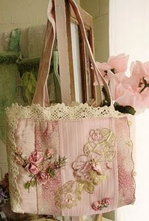 Pink:  Pink handbag with roses and lace.