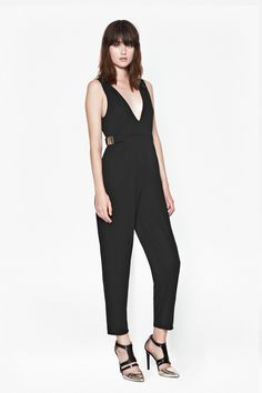 f851663d93 Full-length jumpsuit in stretchy jersey crepe fabric Plunging V-neckline  Sleeveless Centre back exposed zip Elasticated waist with metallic bar  details UK ...