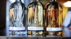 Milagro's Select Barrel Reserve bottles with spiky glass agave plants blown into the bottom