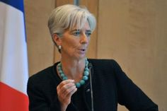 Christine Lagarde in dark Chanel suit and accessorized with a Large Round Faceted Amazonite necklace.