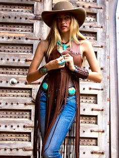 ❤ Cowgirls ~ From Brit West's Fall 2015 collection: a beautiful long fringed Wild West leather vest. Priced at $998.00. Love the turquoise concho belt, hat and turquoise jewelry she's famous for. ~