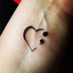 Almost like a lifeline, this heart and semicolon tattoo is one of the most common designs.