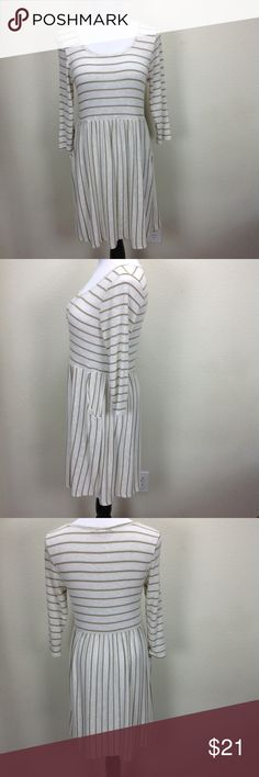 Forever 21 Tan & Cream Striped Dress Lightweight tan and cream striped dress with horizontal striped bodice and vertical striped full skirt pockets.  The dress has quite a bit of stretch.  In excellent condition with no visible stains, holes or piling.  Thanks for your interest!  Please checkout the rest of my closet. Forever 21 Dresses Midi
