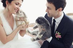 Take note I want a bunny at my wedding reception... actually lots of them running around the grass.
