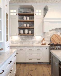 I like the gray brick backsplash - subtle, and a little different from what I've been seeing all over the place.