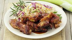 HONEY BARBEQUE DRUMETTES WITH CRUNCHY COLESLAW - These tasty mini-drumsticks are a real crowd-pleaser, and when paired with the crunch of cabbage and crispy fried noodles they'll appeal to any palate.