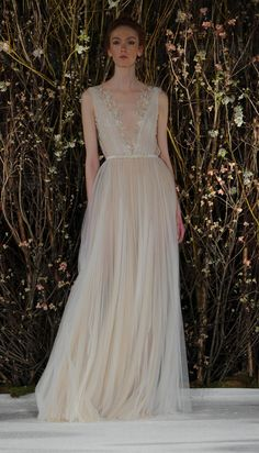 Tulle gown with plunging neckline and floral appliques | Mira Zwillinger Spring 2017 | https://www.theknot.com/content/mira-zwillinger-wedding-dresses-bridal-fashion-week-spring-2017