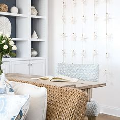 In large, open living spaces, creating spots to break away from the group while still being with everyone is important, Pitts says. In a living room corner, a chair covered in a patterned linen fabric accompanies a flip-top console table that doubles as a